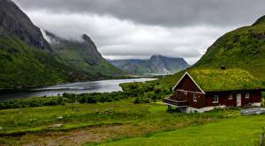 Обои Норвегия Лофотенские острова Горы Здания Залив Природа