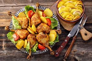 Фотография Курица запеченная Картошка Нож Продукты питания