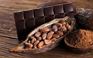 Картинка Сладости Шоколад Орехи Шоколадная плитка Доски Пища