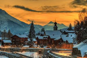 Картинка Швейцария Горы Дома Зима Вечер Снег Ель Blitzingen Goms Города
