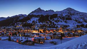 Обои Швейцария Гора Здания Зимние Вечер Снегу Davos Города