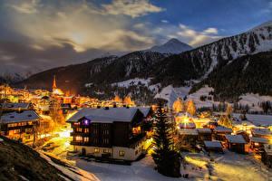 Обои Швейцария Зима Дома Горы Вечер Снег Ели Goms город