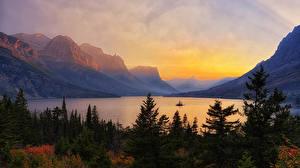Картинка Штаты Парки Горы Озеро Рассветы и закаты Пейзаж Ель Glacier National Park Природа