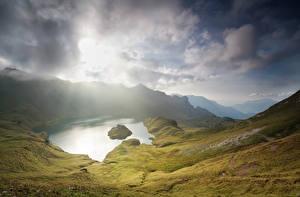 Картинки Австрия Горы Озеро Небо Альпы Природа
