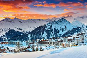 Фото Франция Курорты Дома Горы Зимние Альпы Снег Облака Le Corbier Города