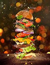 Фотографии Гамбургер Булочки Мясные продукты Овощи Сыры Брызги