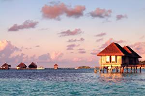 Фото Мальдивы Тропики Море Небо Бунгало Природа