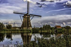 Фото Нидерланды Речка Здания Небо Мельница Kinderdijk