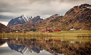 Фотография Норвегия Лофотенские острова Горы Здания Побережье Природа