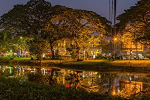 Картинка Парки Вечер Пруд Деревья Уличные фонари Hard Rock Cafe Park Cambodia Природа