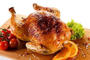 Фотография Курица запеченная Томаты Цитрусовые Разделочная доска