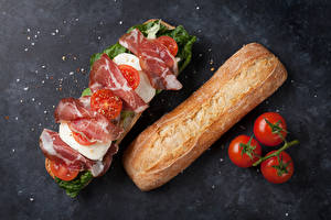 Фото Сэндвич Бутерброды Булочки Ветчина Помидоры Еда