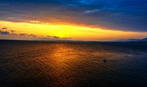 Картинка Море Рассветы и закаты Небо Природа