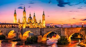 Обои Испания Дома Реки Мосты Вечер Уличные фонари Zaragoza Города