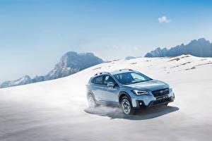 Картинки Субару Голубой Металлик Снег Едущий 2017-18 XV Worldwide Авто