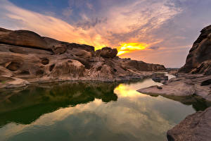 Картинка Таиланд Парки Рассветы и закаты Речка Утес Sampanbok natural stone park  Ubonratchathani