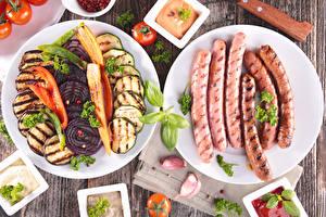Фотографии Овощи Мясные продукты Сосиска Чеснок Тарелка Нарезка