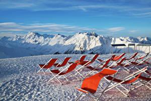Картинки Австрия Горы Зимние Альпы Снег Шезлонг Природа