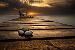 Обои Болгария Рассветы и закаты Причалы Камень Море Небо Varna Природа