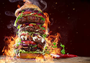 Фотография Быстрое питание Гамбургер Мясные продукты Овощи Пламя Пища