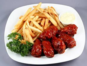 Фото Картофель фри Мясные продукты Тарелка