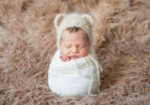 Фотография Грудной ребёнок Шапки Спит Ребёнок
