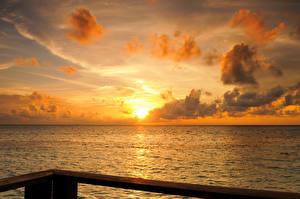Фото Мальдивы Море Рассветы и закаты Небо Облака Природа