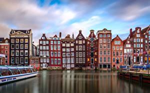 Картинка Нидерланды Амстердам Здания Причалы Водный канал Города