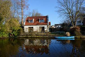 Картинка Нидерланды Здания Речка Лодки Ограда Abcoude Города