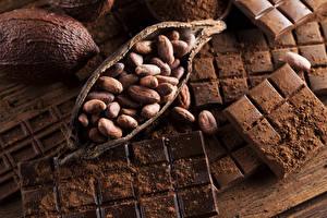 Картинка Сладости Шоколад Орехи Шоколадная плитка Пища Еда