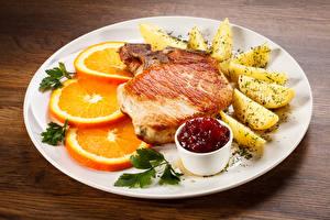 Картинки Вторые блюда Мясные продукты Картошка Апельсин Тарелка Кетчуп