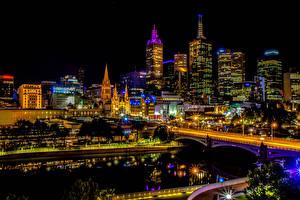 Фотографии Австралия Мельбурн Здания Небоскребы Реки Мост Вечер Уличные фонари город
