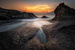 Обои Болгария Берег Рассветы и закаты Скала