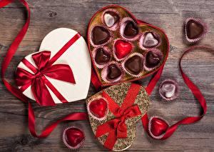 Фотографии Конфеты День святого Валентина Коробка Сердечко Бантик Еда