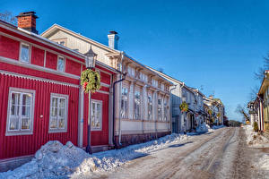 Фото Финляндия Дома Зима Улица Снег Уличные фонари Naantali Города