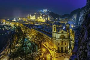 Фото Зальцбург Австрия Здания Зимние Ночные Утес Снег Города