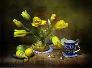 Картинки Натюрморт Тюльпаны Лимоны Желтый Чашка Цветы
