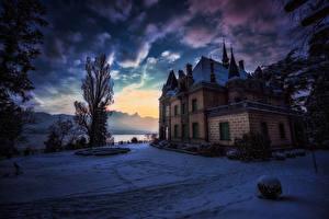 Картинка Швейцария Зимние Замки Вечер Небо Снег Кусты Hunegg Castle Hilterfingen город