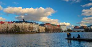 Фотография Финляндия Хельсинки Здания Речка Ловля рыбы Пирсы Города
