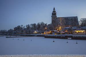 Фотографии Финляндия Здания Зима Речка Причалы Вечер Снег Naantali