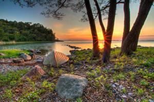 Обои Финляндия Реки Берег Рассветы и закаты Камни Лодки Деревья Hanko Uusimaa Природа