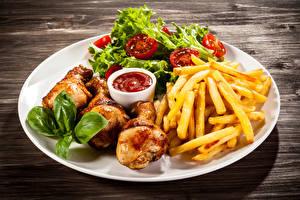 Картинки Картофель фри Курица запеченная Овощи Тарелка Кетчуп Пища