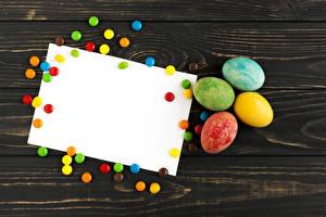 Обои Праздники Пасха Конфеты Доски Яйца Шаблон поздравительной открытки Разноцветные