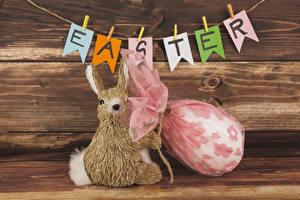 Фотографии Праздники Пасха Кролики Доски Яйца Английский Прищепки