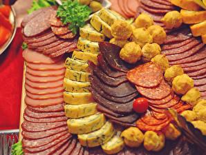 Фотография Мясные продукты Колбаса Сыры Ветчина Нарезка Пища