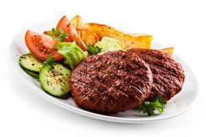 Фотография Мясные продукты Овощи Белый фон Еда