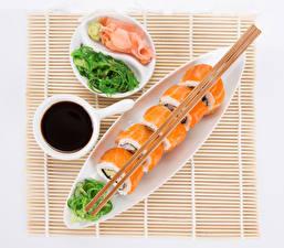 Фото Морепродукты Суси Тарелке Палочки для еды Соевый соус