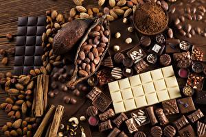 Обои Сладости Шоколад Орехи Конфеты Шоколадка Какао порошок