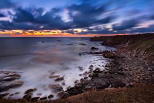 Фото Болгария Берег Рассветы и закаты Камень Небо Природа