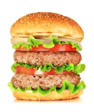 Фотография Фастфуд Гамбургер Булочки Мясные продукты Томаты Белый фон Продукты питания